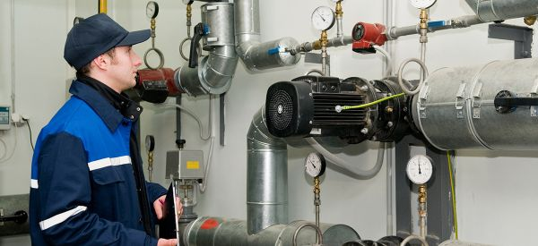 maintenance engineer in boiler room for pre commissioning